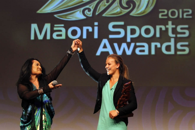 Olympic Gold Medalist Lisa Carrington is awarded the Albie Pryor Memorial Maori Sportsperson of the Year 2012. Pictured here with singer songwriter Annie Crummer. Maori Sports Awards, Telstra Pacific Events Centre Manukau, Saturday 24th November 2012. Photo: Shane Wenzlick / Photosport.co.nz