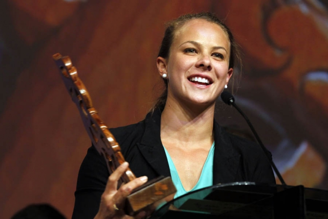 Olympic gold medalist Lisa Carrington is awarded with the Albie Pryor Memorial Maori Sportsperson of the Year. Maori Sports Awards, Telstra Pacific Events Centre Manukau, Saturday 24th November 2012. Photo: Shane Wenzlick / Photosport.co.nz