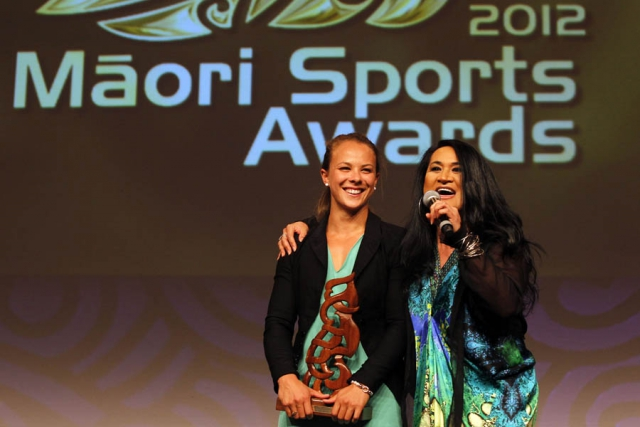 Olympic gold medalist Lisa Carrington is awarded with the Albie Pryor Memorial Maori Sportsperson of the Year. Pictured with singer / songwriter Annie Crummer. Maori Sports Awards, Telstra Pacific Events Centre Manukau, Saturday 24th November 2012. Photo: Shane Wenzlick / Photosport.co.nz