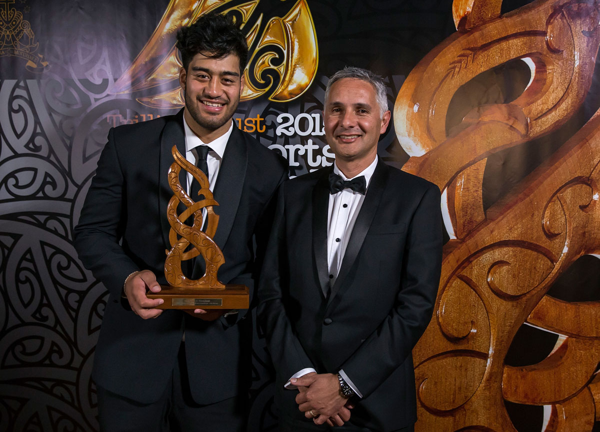 Akira Ioane, (Te Whanau-a-Apanui, Ngapuhi), Rugby receives the the Junior Maori Sportsman Award from Mike Taitoko from MRP at the Trillian Trust Maori Sports Awards, Turangawaewae Marae, River Road, Ngaruawahia, Saturday, November 28, 2015. Copyright photo: David Rowland / www.photosport.nz