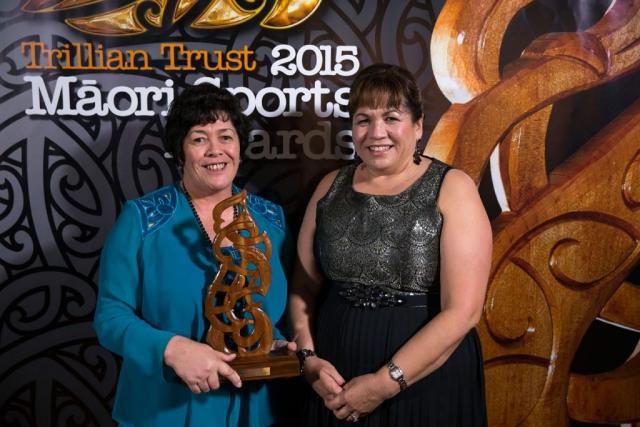 Heneriata Milner, left, accepts the Senior Maori Sportsman Award on behalf of her son Nehe Milner-Skudder, (Ng?ti Porou, Tapuika), Rugby frpm Hinerangi Raumati from AFL at the Trillian Trust Maori Sports Awards, Turangawaewae Marae, River Road, Ngaruawahia, Saturday, November 28, 2015. Copyright photo: David Rowland / www.photosport.nz