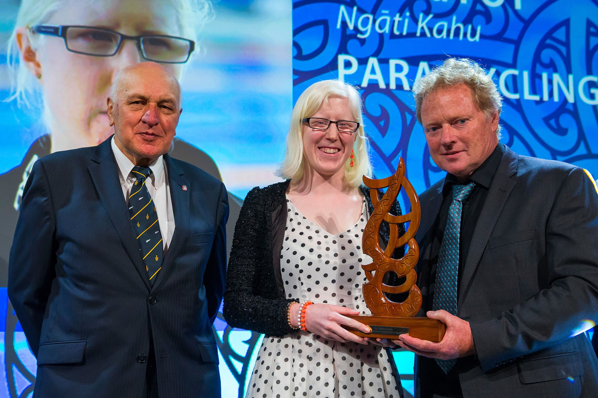 Sir Tamati Reedy, left, and Dennis Watson from Watson & Son present to Emma Foy, (Ngati Kahu), Para-Cycling the Disabled Maori Sports Person Award at the Trillian Trust Maori Sports Awards, Turangawaewae Marae, River Road, Ngaruawahia, Saturday, November 28, 2015. Copyright photo: David Rowland / www.photosport.nz