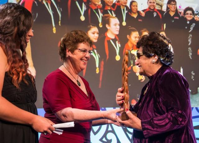 Audrey Hauraki from Erhard Trust presents to Dame June Mariu the Maori Sports Team Award who accepts on behalf of the Aotearoa Maori Secondary Schools Team at the Trillian Trust Maori Sports Awards, Turangawaewae Marae, River Road, Ngaruawahia, Saturday, November 28, 2015. Copyright photo: David Rowland / www.photosport.nz
