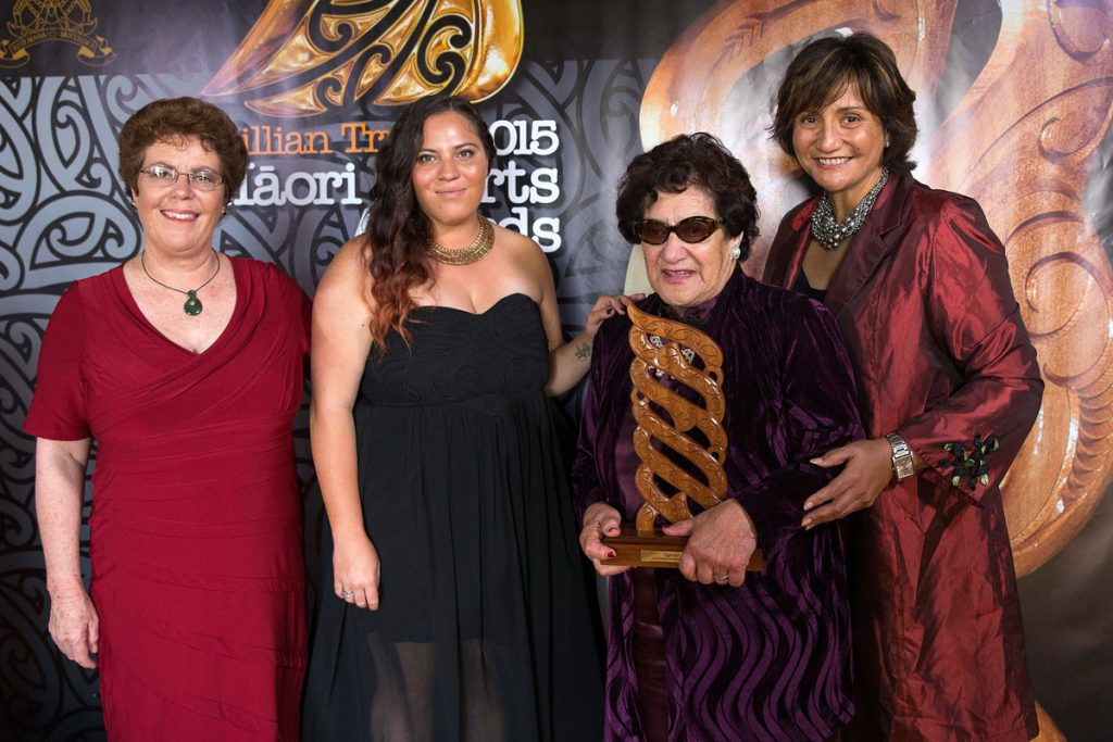 Audrey Hauraki from Erhard Trust, left, presents to Dame June Mariu the Maori Sports Team Award who accepts on behalf of the Aotearoa Maori Secondary Schools Team at the Trillian Trust Maori Sports Awards, Turangawaewae Marae, River Road, Ngaruawahia, Saturday, November 28, 2015. Copyright photo: David Rowland / www.photosport.nz