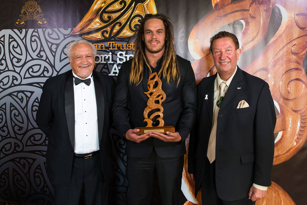 Dan Pryor accepts the Maori Sports Coach Award on behalf of Jamie Joseph, (Rangitane), Rugby from Sir Toby Curtis, left, and Trevor Maxwell NZCT at the Trillian Trust Maori Sports Awards, Turangawaewae Marae, River Road, Ngaruawahia, Saturday, November 28, 2015. Copyright photo: David Rowland / www.photosport.nz