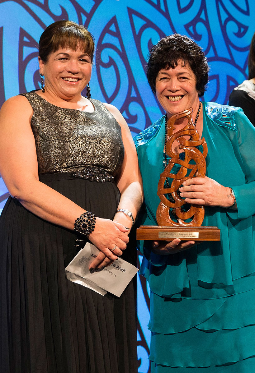 Heneriata Milner, right, accepts the Senior Maori Sportsman Award on behalf of her son Nehe Milner-Skudder, (Ngati Porou, Tapuika), Rugby frpm Hinerangi Raumati from AFL at the Trillian Trust Maori Sports Awards, Turangawaewae Marae, River Road, Ngaruawahia, Saturday, November 28, 2015. Copyright photo: David Rowland / www.photosport.nz
