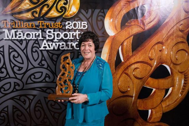 Heneriata Milner accepts the Senior Maori Sportsman Award on behalf of her son Nehe Milner-Skudder, (Ngati Porou, Tapuika), Rugby at the Trillian Trust Maori Sports Awards, Turangawaewae Marae, River Road, Ngaruawahia, Saturday, November 28, 2015. Copyright photo: David Rowland / www.photosport.nz
