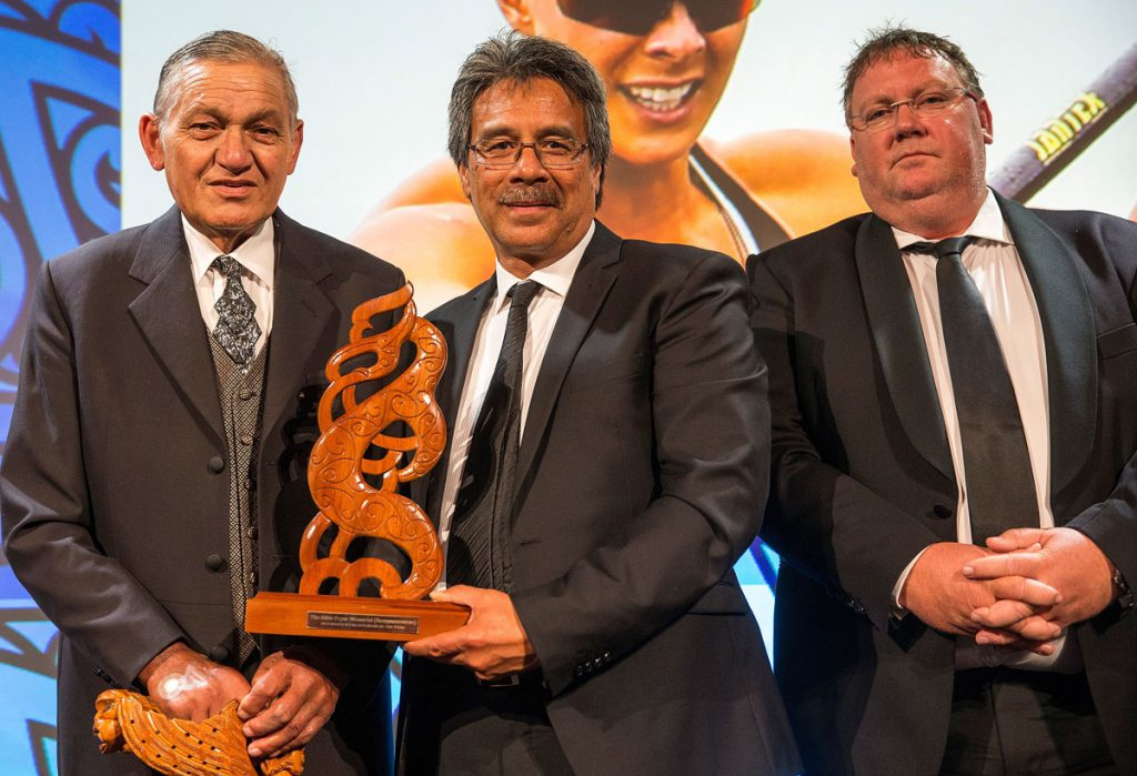 Kiingi Tuheitia and Dean Agnew from Trillian present the Albie Pryor Memorial Maori Sportsperson of the Year Award to Pat Carrington who accepted on behalf of Lisa Carrington, (Ngati Porou, Te Aitanga-a-Mahaki), Canoe Racing at the Trillian Trust Maori Sports Awards, Turangawaewae Marae, River Road, Ngaruawahia, Saturday, November 28, 2015. Copyright photo: David Rowland / www.photosport.nz