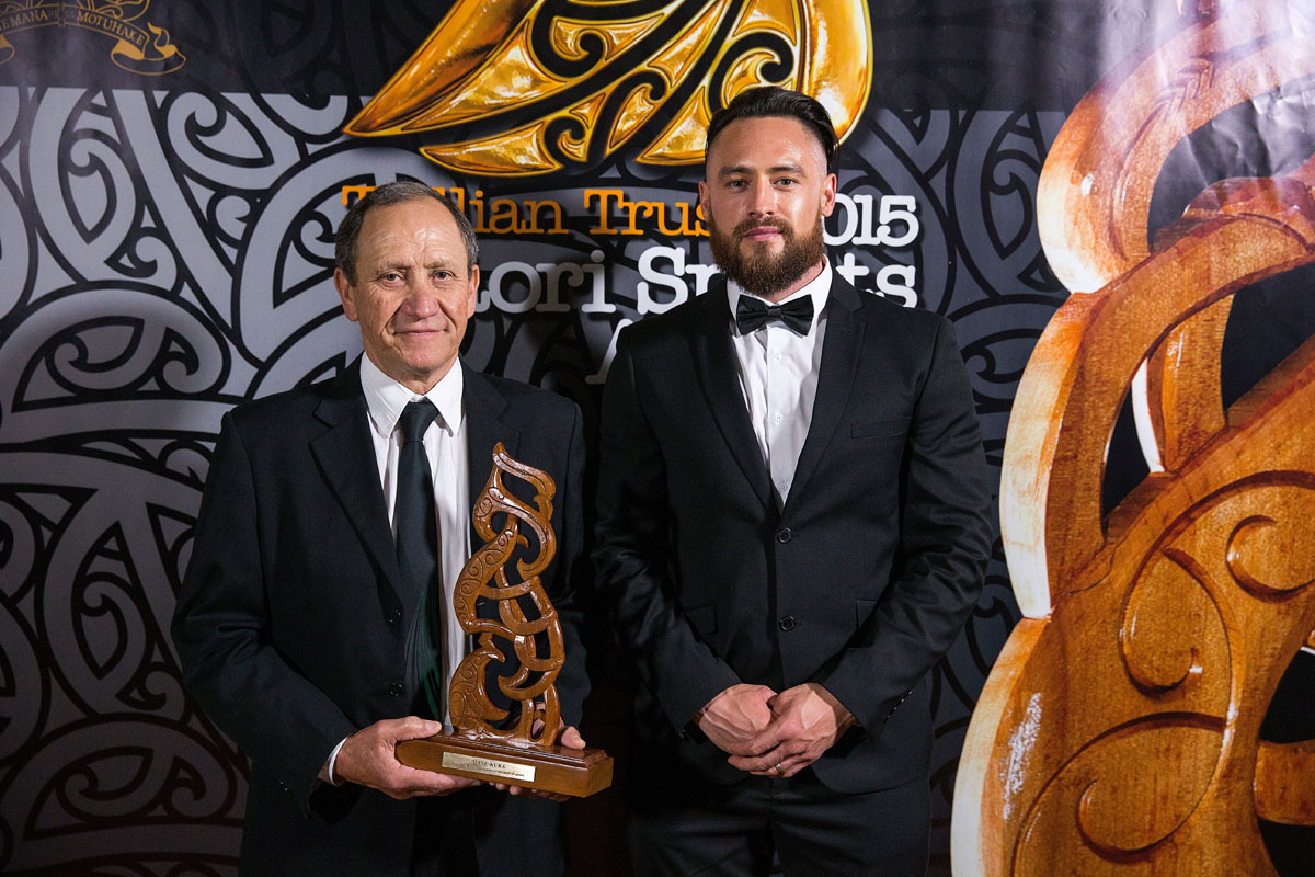 Issac Carlson from ACC presents to Bruce Campbell on behalf of Michael Campbell the Manu - Kura - Best maori sportsman of the past 25 years Award at the Trillian Trust Maori Sports Awards, Turangawaewae Marae, River Road, Ngaruawahia, Saturday, November 28, 2015. Copyright photo: David Rowland / www.photosport.nz