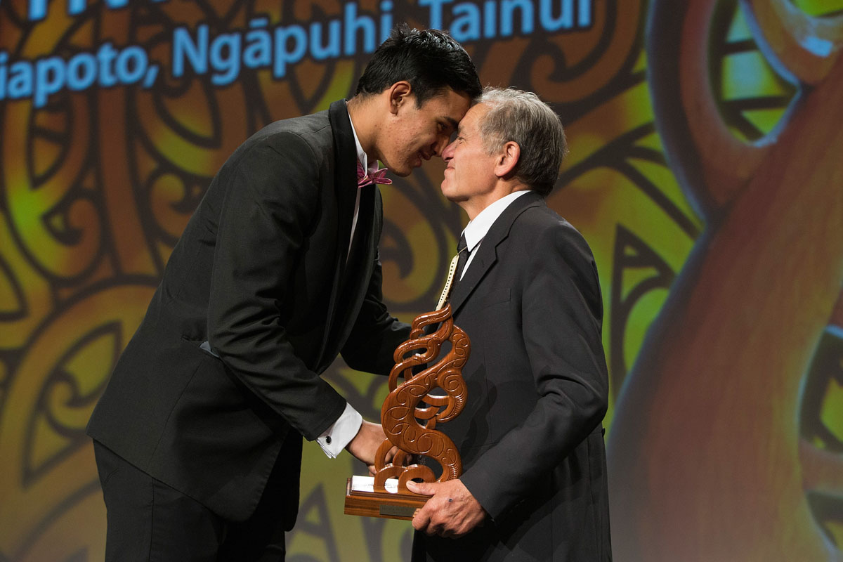 Tai Hikuroa Wynyard receives the Albie Pryor Memorial Maori Sportsperson of the Year from the Maori King Kiingi Tuheitia at the Maori Sports Awards 2014, Vodafone Events Centre, Manukau, Auckland, New Zealand, Saturday, November 29, 2014. Photo: David Rowland/Photosport