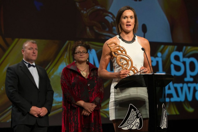 Senior Maori Sportswoman was awarded to rower Fiona Bourke by Mark Leech (L) and Louisa Wall (C) at the Maori Sports Awards 2014, Vodafone Events Centre, Manukau, Auckland, New Zealand, Saturday, November 29, 2014. Photo: David Rowland/Photosport