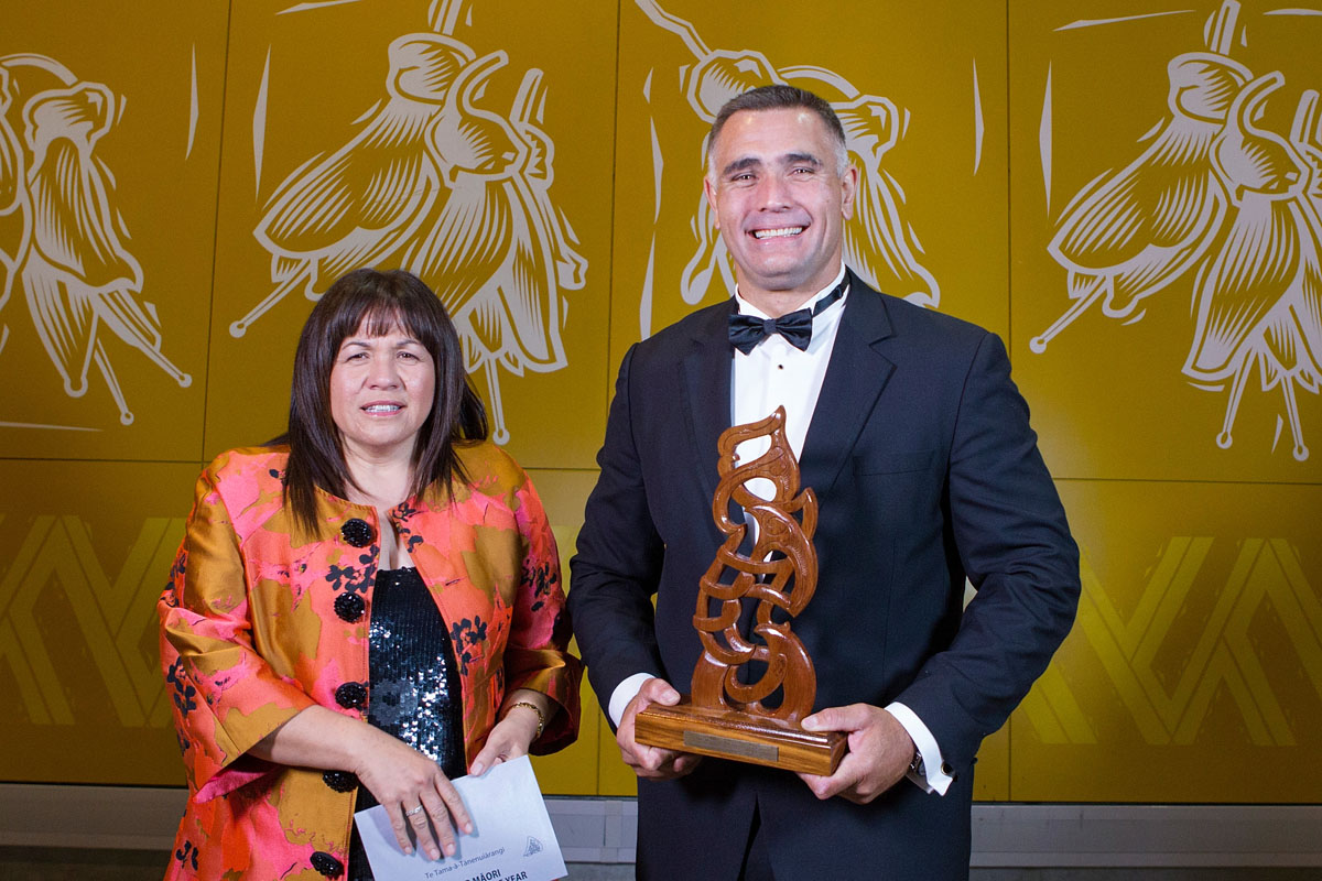 Senior Maori Sportsman is awarded to wood chopper and power sawing`s Jason Wynyard (R) by Hinerangi Raumati at the Maori Sports Awards 2014, Vodafone Events Centre, Manukau, Auckland, New Zealand, Saturday, November 29, 2014. Photo: David Rowland/Photosport