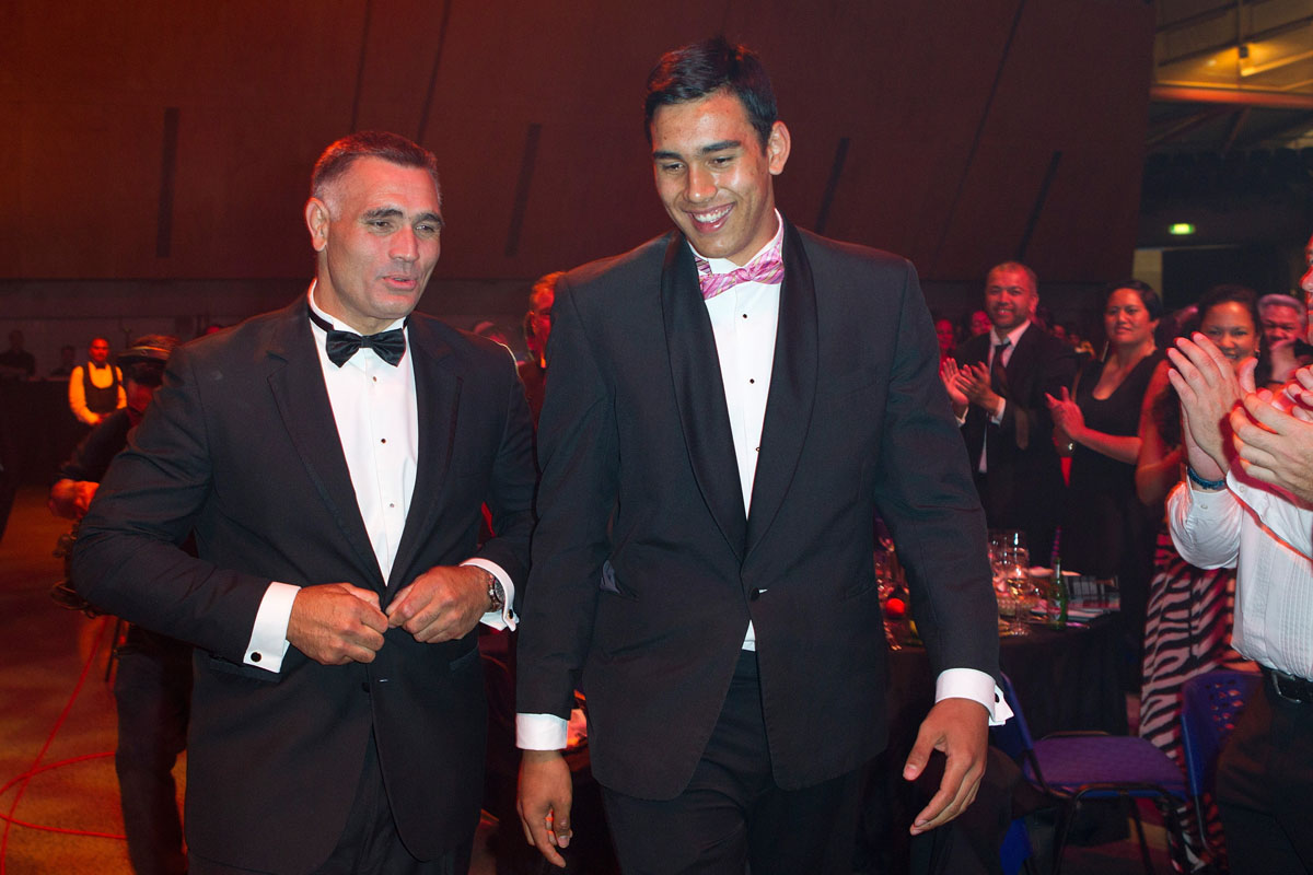 Father and son, Jason (L) and Tai wynyard make their way to the stage to accept the Albie Pryor Memorial Maori Sportsperson of the Year at the Maori Sports Awards 2014, Vodafone Events Centre, Manukau, Auckland, New Zealand, Saturday, November 29, 2014. Photo: David Rowland/Photosport