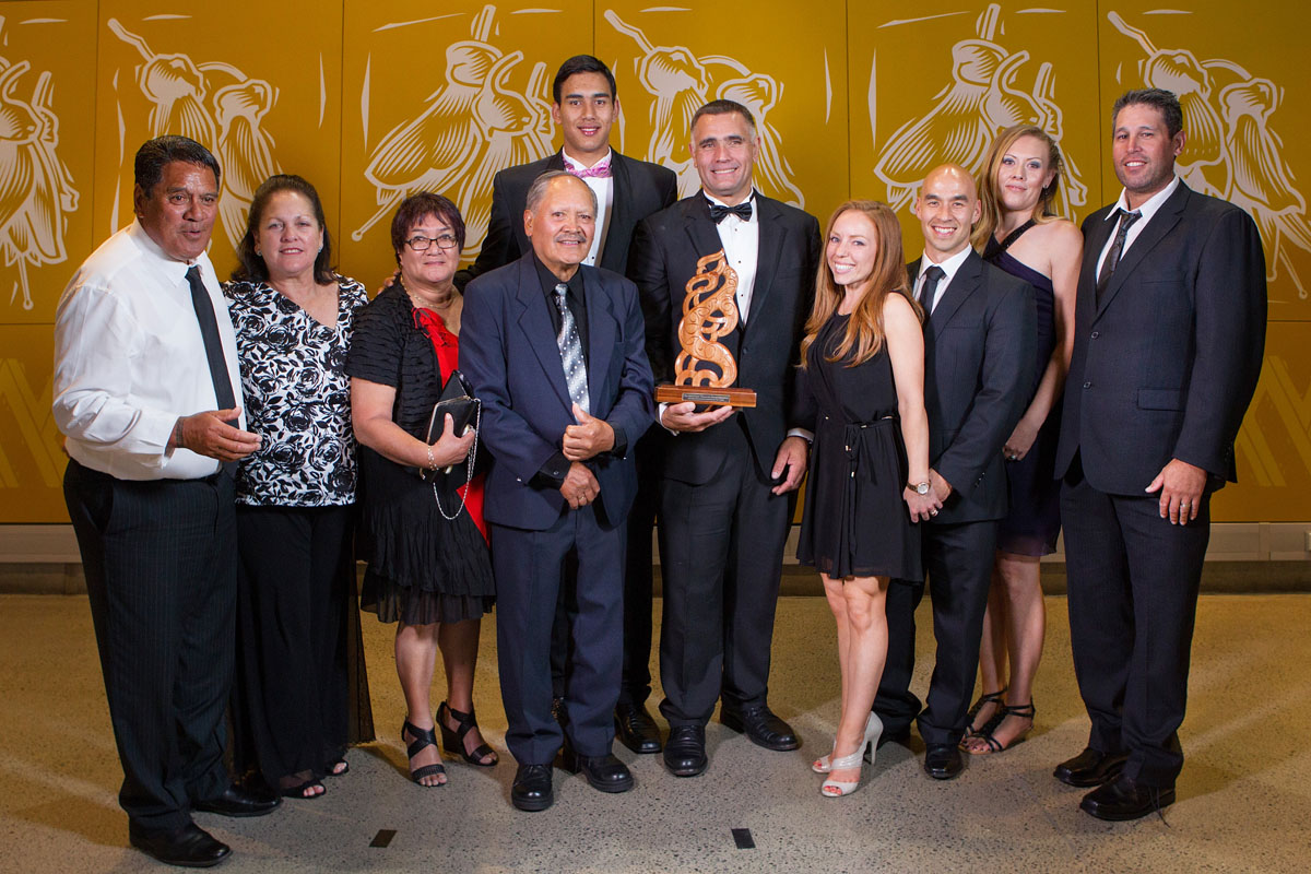 With family members the Albie Pryor Memorial Maori Sportsperson of the Year was awarded to father and son, basketball`s Tai (C) and woodchopping`s Jason Wynyard at the Maori Sports Awards 2014, Vodafone Events Centre, Manukau, Auckland, New Zealand, Saturday, November 29, 2014. Photo: David Rowland/Photosport