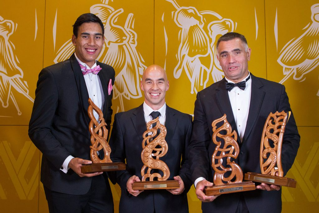 With Adam Storey (C), father and son Tai (L) and Jason Wynyard (R) hold their awards including Junior Maori Sportsman , Senior Maori Sportsman  and Albie Pryor Memorial Maori Sportsperson of the Year won at the Maori Sports Awards 2014, Vodafone Events Centre, Manukau, Auckland, New Zealand, Saturday, November 29, 2014. Photo: David Rowland/Photosport