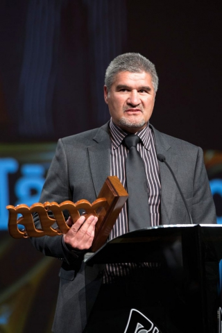 Maori Sports Team was awarded to the Maori All Blacks with coach Colin Cooper receiving the trophy  at the Maori Sports Awards 2014, Vodafone Events Centre, Manukau, Auckland, New Zealand, Saturday, November 29, 2014. Photo: David Rowland/Photosport