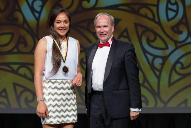 Auckland Mayor Len Brown presents the Auckland Council Maori in World Champions Award to rafting`s Taylor Taute-Hohepa (L) at the Maori Sports Awards 2014, Vodafone Events Centre, Manukau, Auckland, New Zealand, Saturday, November 29, 2014. Photo: David Rowland/Photosport