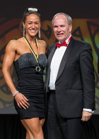 Auckland Mayor Len Brown presents the Auckland Council Maori in World Champions Award to pro figure`s Teneka Hyndman (L) at the Maori Sports Awards 2014, Vodafone Events Centre, Manukau, Auckland, New Zealand, Saturday, November 29, 2014. Photo: David Rowland/Photosport