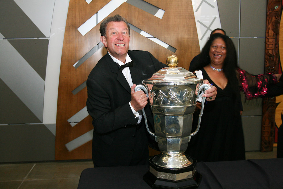 Deputy Mayor Trevor Maxwell holding the Rugby League World Cup