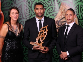 2013 NZU20 All Blacks and Auckland Blues rugby player Joe Edwards wins the Junior Maori Sportsman of the Year award pictured with Tania Simpson and Luke McAlister at the Trillian Trust Maori Sports Awards at Vodafone Events Centre, Manukau. Photo: Fiona Goodall/photosport.co.nz