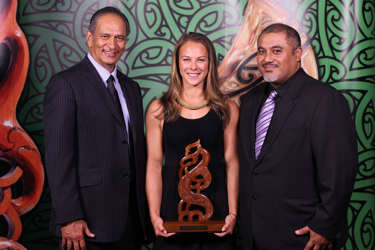 2013 Olympic gold medal winning canoeist Lisa Carrington, centre with presenters Dean Agnew, right and Kevin Pryor, left, wins the Maori Sportsperson of the Year and the Senior Maori Sportswoman awards at the Trillian Trust Maori Sports Awards at Vodafone Events Centre, Manukau. Photo: Fiona Goodall/photosport.co.nz