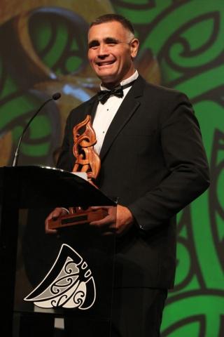 2013 Wood Chopping Champion Jason Wynyard with the Senior Maori Sportsman of the Year award at the Trillian Trust Maori Sports Awards at Vodafone Events Centre, Manukau. Photo: Fiona Goodall/photosport.co.nz