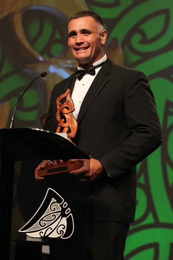 2013 Wood Chopping Champion Jason Wynyard with the Senior Maori Sportsman of the Year award at the Trillian Trust Maori Sports Awards at Vodafone Events Centre, Manukau. Photo: Fiona Goodall/photosport.co.nz