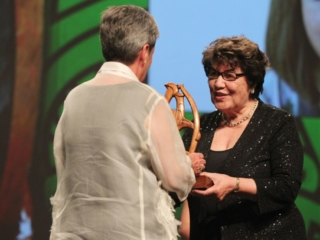 2013  Kahurangi Te Koingo Reedy presents the Maori Sports Administrator award to Raelene Castle for netball and rugby league. Her mother Marlene accepts the award at the Trillian Trust Maori Sports Awards at Vodafone Events Centre, Manukau. Photo: Fiona Goodall/photosport.co.nz