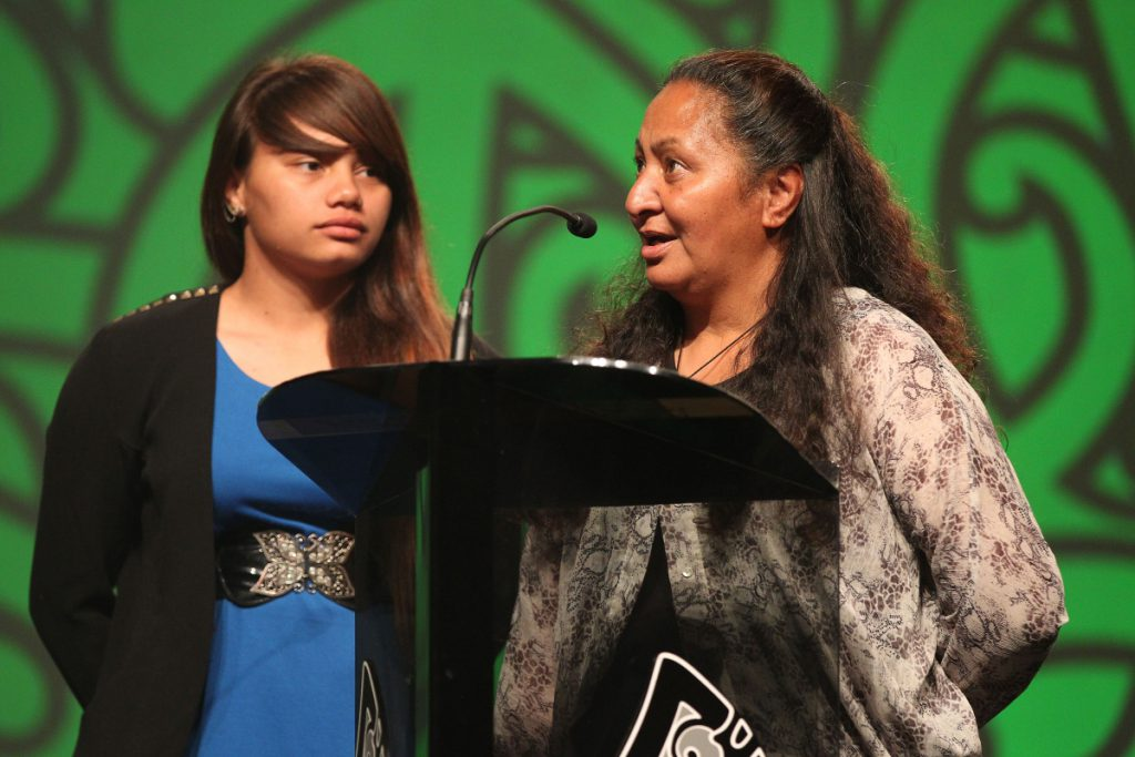 2013  Kukupa Tirikatene of MIT presents the Moari Sports awards scholarships to Waikohika Flesher, and Corey Tawhi's mum Jesse, right at the Trillian Trust Maori Sports Awards at Vodafone Events Centre, Manukau. Photo: Fiona Goodall/photosport.co.nz