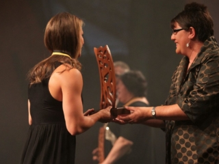 2013  Michelle Hippolite, right presents the individual Maori world champion awards to Lisa Carrington for canoeing at the Trillian Trust Maori Sports Awards at Vodafone Events Centre, Manukau. Photo: Fiona Goodall/photosport.co.nz