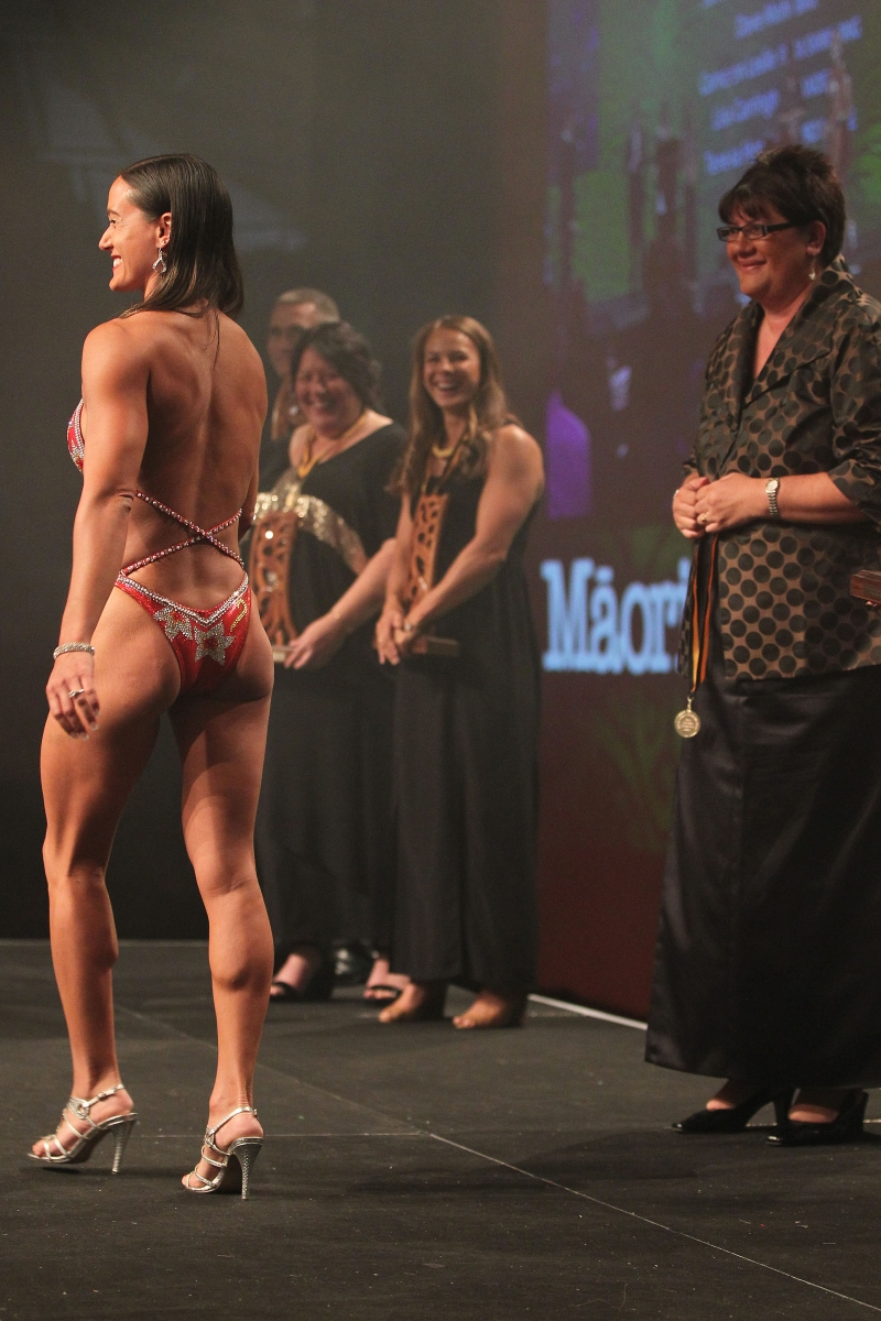 2013  Michelle Hippolite, right presents the individual Maori world champion awards to Teneka Hyndman for pro figure body building  at the Trillian Trust Maori Sports Awards at Vodafone Events Centre, Manukau. Photo: Fiona Goodall/photosport.co.nz