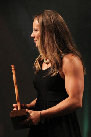 2013  Jenny-May Coffin presents the award for senior Maori sportswoman to Lisa Carrington at the Trillian Trust Maori Sports Awards at Vodafone Events Centre, Manukau. Photo: Fiona Goodall/photosport.co.nz