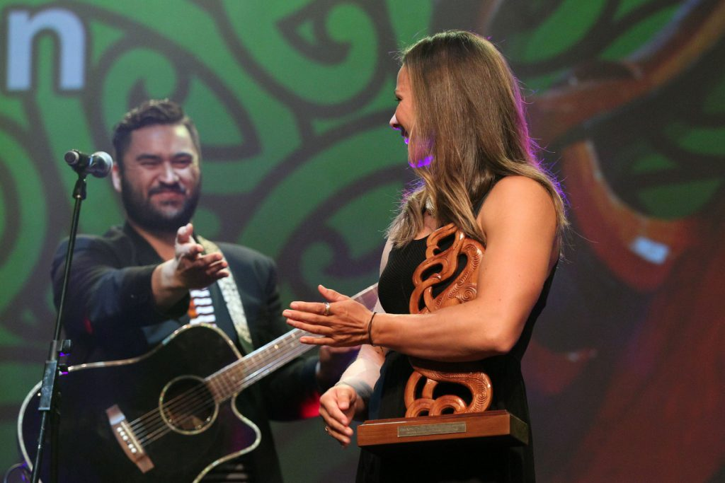 2013  Tama Waipara, left and Maisey Rika sing to the new Maori Sportsperson of the Year, Lisa Carrington for canoeing at the Trillian Trust Maori Sports Awards at Vodafone Events Centre, Manukau. Photo: Fiona Goodall/photosport.co.nz