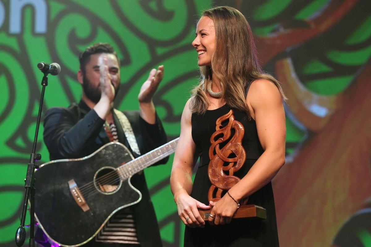 2013  Tama Waipara, left and Maisey Rika sing to the new Maori Sportsperson of the Year, Lisa Carrington for canoeing at the Trillian Trust Maori Sports Awards at Vodafone Events Centre, Manukau. Photo: Fiona Goodall/photosport.co.nz